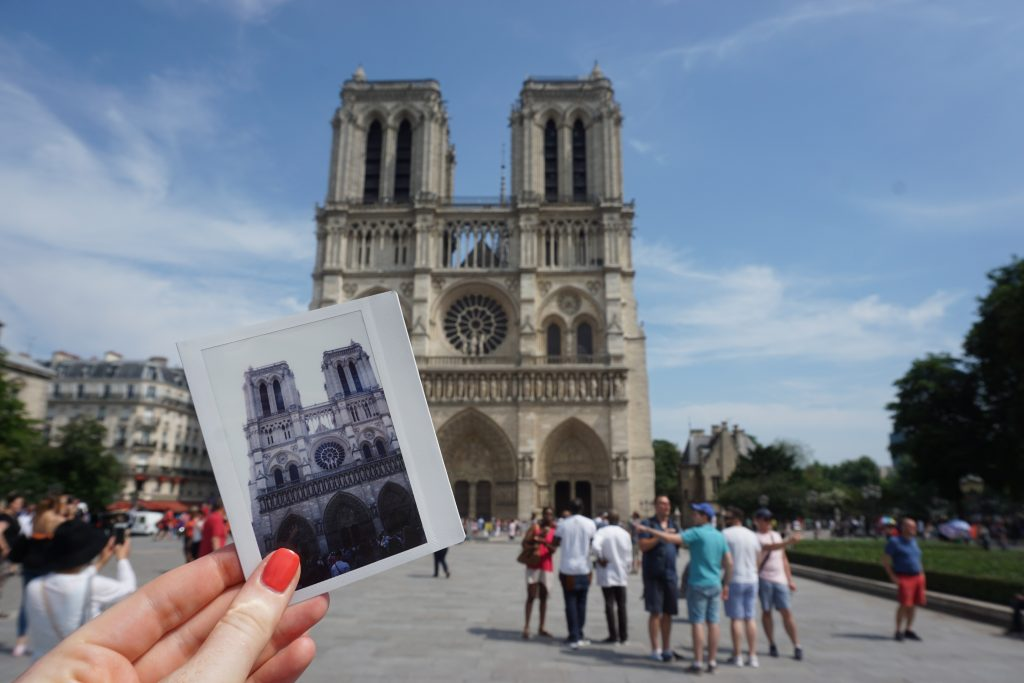 Polaroid photo of Notre Dame in front of Notre Dame